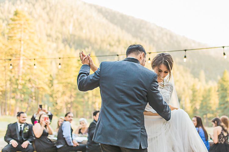 Outdoor Reception Bride Watters Separates Lace Top Tulle Skirt Veil Groom Dark Blue Jacket Black Pants Dancing Guests Hanging Fairy Lights DIY Whimsical Camp Wedding California http://www.landbphotography.org/