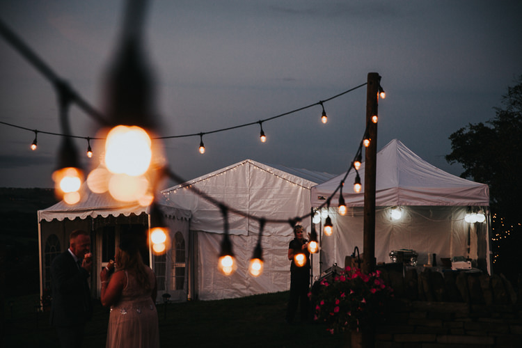 Festoon Lights Beautiful Flowery Country Marquee Wedding http://www.maddiefarrisphotography.co.uk/