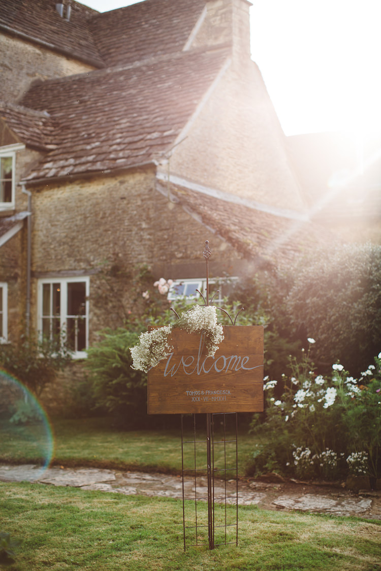 Wooden Rustic Welcome Sign Flowers Cotswolds Country House Marquee Wedding http://www.wearegatheredheretoday.com/