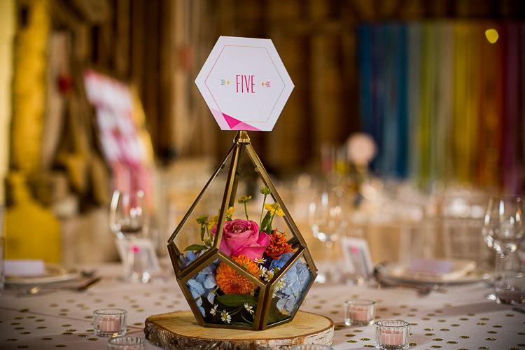 Terranuim Flower Centrepiece Number Table Log Fun Multicolour Creative Barn Wedding http://www.mattparryphotography.co.uk/