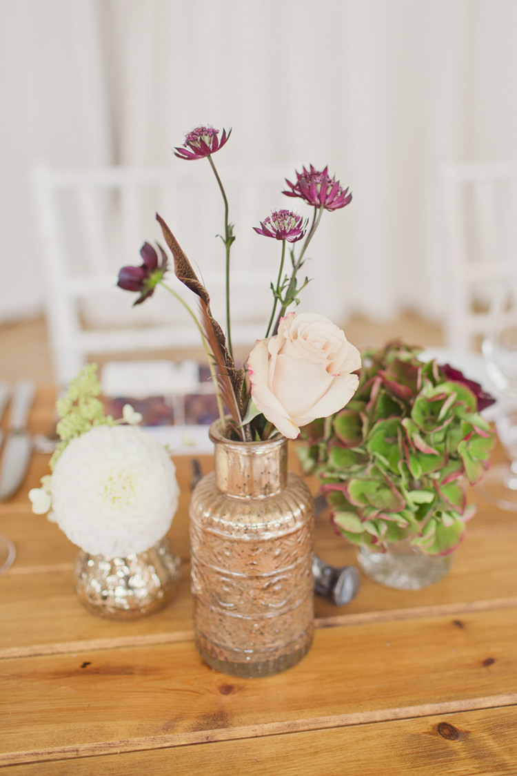 Bottle Flowers Decor Antler Feather Stunning Countryside Wedding http://www.cottoncandyweddings.co.uk/