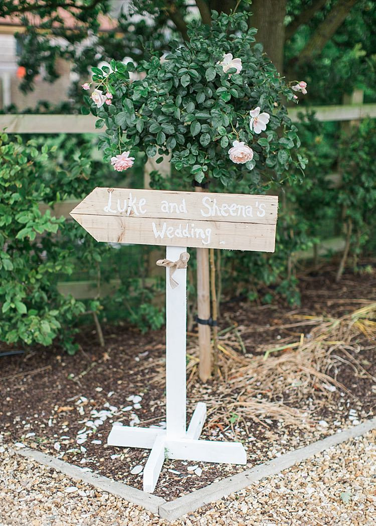 Rustic Direction Sign Wooden Post Romantic Soft Pastels Barn Wedding http://www.sungblue.com/