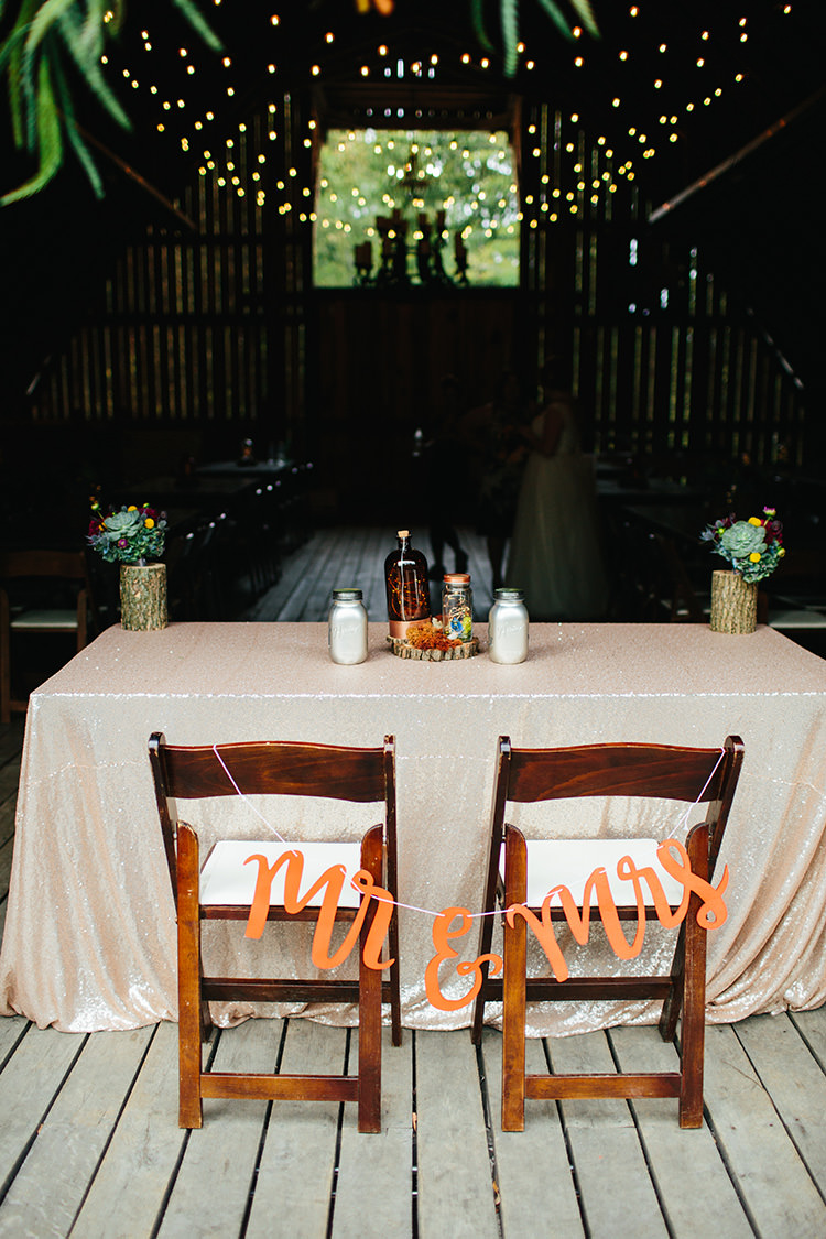 Reception Bride Groom Table Mr Mrs Sign Tree Trunk Vases Multicoloured Flowers Succulents Homemade Centrepiece Hanging Fairy Lights Creative Quirky Rustic Barn Wedding Tennessee http://www.alexbeephoto.com/