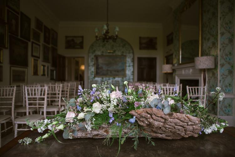Table Flower Arrangement Floral Log Greenery Pastel Floral Easter Spring Woodland Wedding http://emmastonerweddings.com/