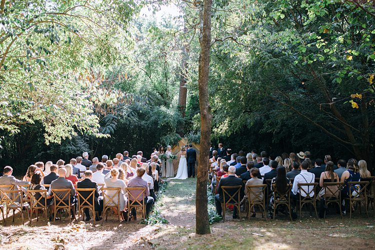 Ceremony Guests Trees Bohemian Outdoor Greenery Wedding Georgia http://www.sowingclover.com/
