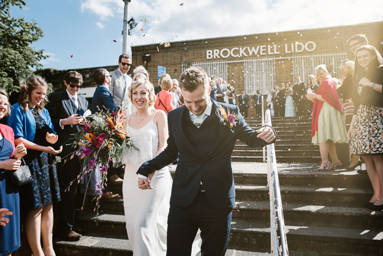 Confetti Throw Bride Groom Married Laid Back Local London Lido Wedding http://andrewbrannanphotography.co.uk/