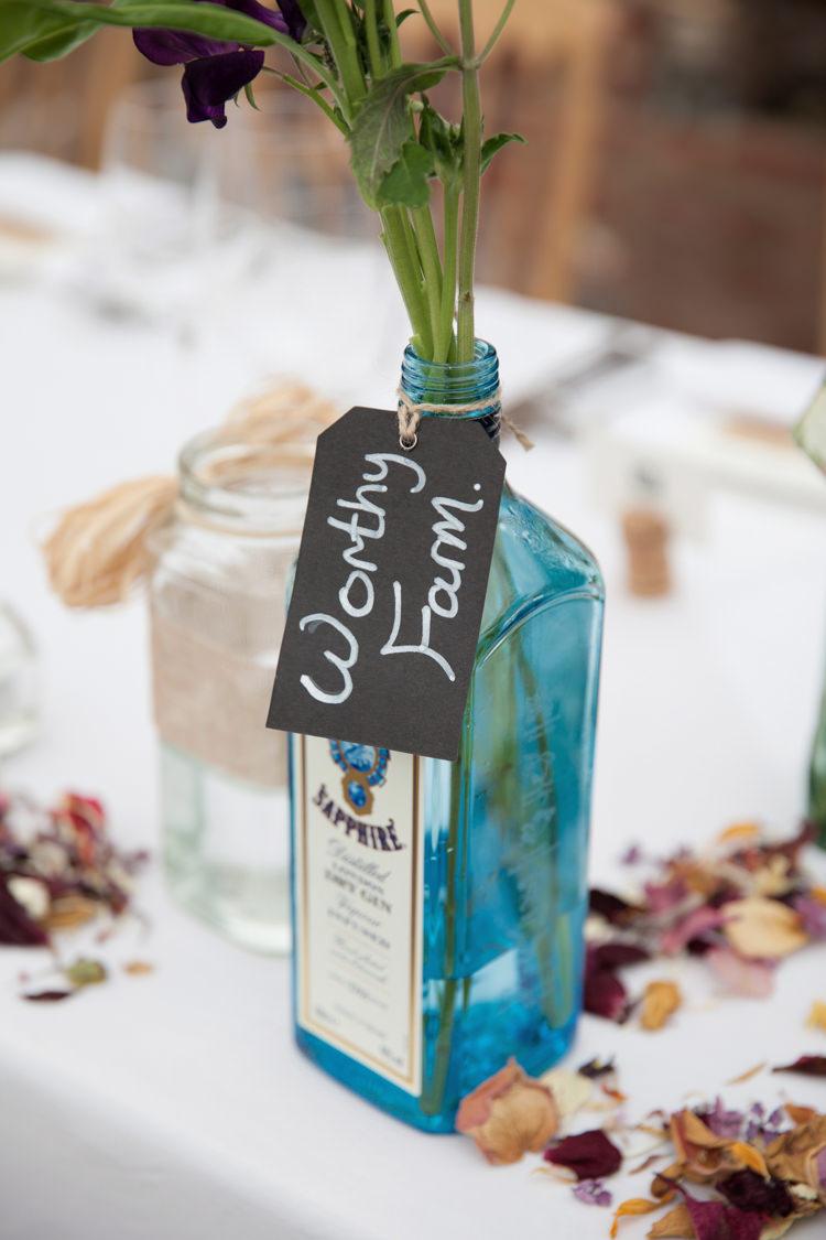 Gin Bottle Flowers Table Names Summer Festival Country Estate Wedding http://kerryannduffy.com/