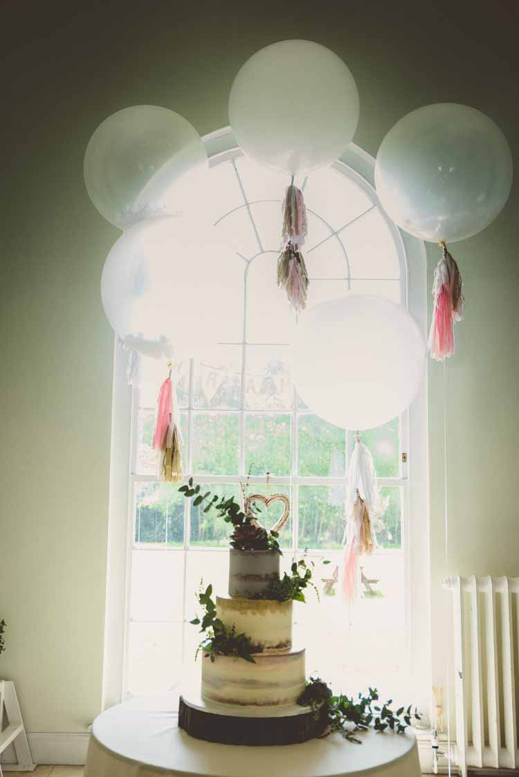 Giant Latex Balloons Paper Tassels Helium Cake Table Half Naked Foliage Eclectic Floral Fun Wedding http://www.photographybypaloma.co.uk/