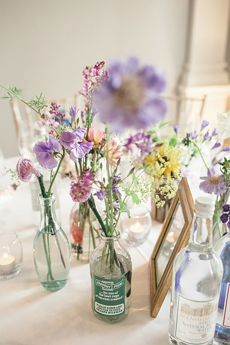 Wild Flowers Bottles Centrepiece Colourful Home Made Vintage City Wedding http://kat-hill.com/