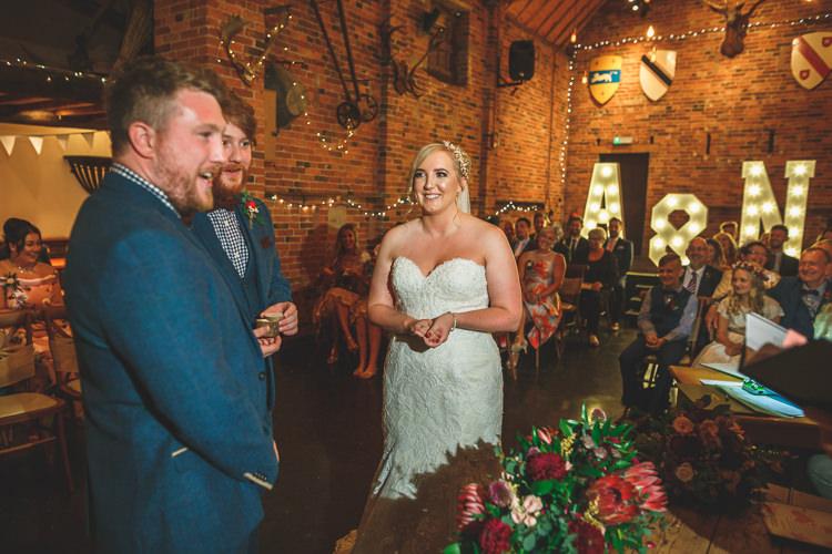 Bride Bridal Sottero & Midgley Sweetheart Neckline Sleeveless Veil Marc Darcy Groom Gingham Shirt Rustic Barn Red Gold Glam Wedding https://garethnewsteadphotography.com/