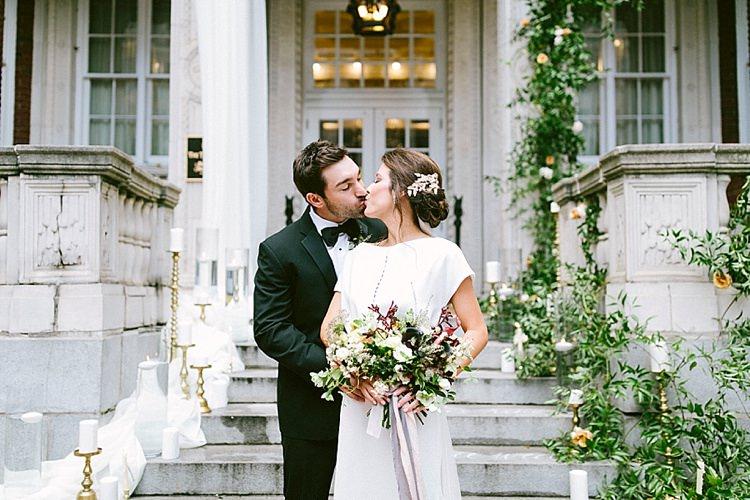 Black Tie Groom Bride Short Sleeve Plain Dress Buttons Long Veil Up Do Gold Tiara Headpiece Bouquet Roses Greenery Kiss Modern Elegance Marble Greenery Gold Wedding Ideas http://www.jettwalkerphotography.com/
