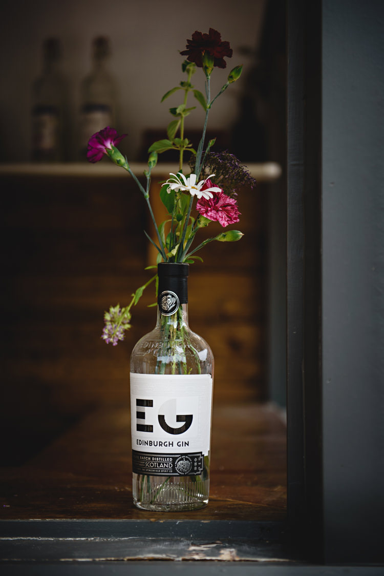 Flowers Gin Bottle Industrial Rose Gold Dove Grey Greenery Wedding http://hbaphotography.com/