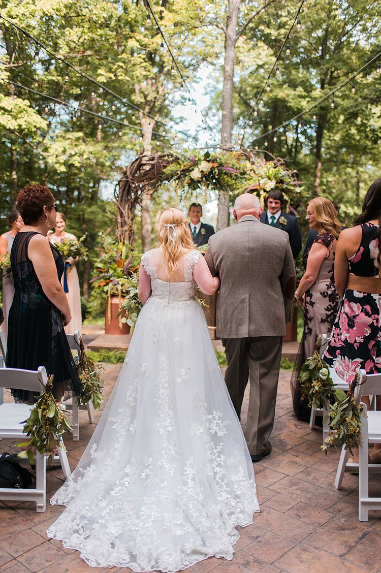 Bride Aisle Lace Train Cap Sleeve Ceremony Outdoors Arch Branches Whimsical Woods Wedding Barn Ohio http://www.connectionphotoblog.com/