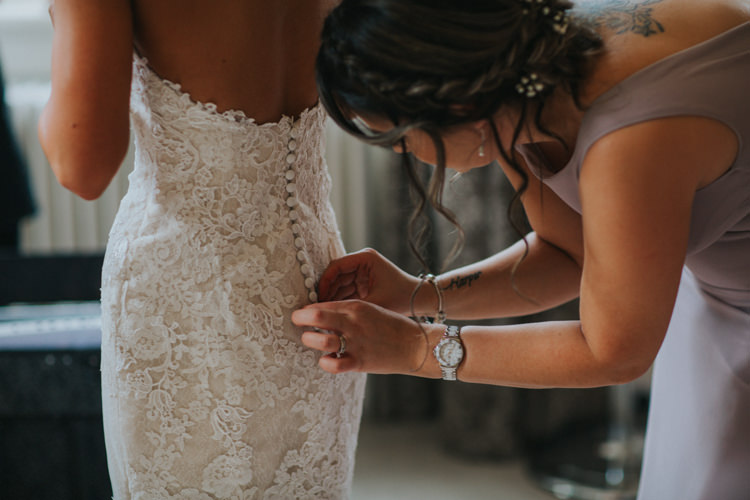 Bride Bridal Pronovias Lace Overlay Button Back Low Chic Romantic Florals Candlelight Wedding http://lisawebbphotography.co.uk/