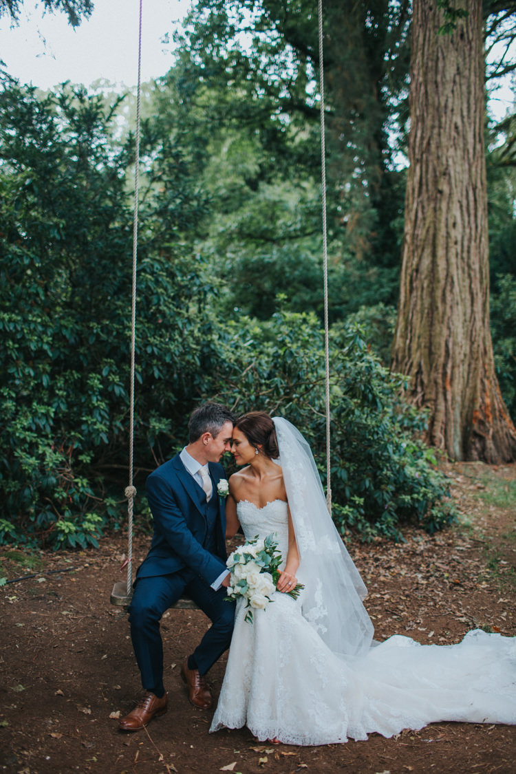 Bride Bridal Pronovias Strapless Sweetheart Fishtail Train Veil White Rose Bouquet Navy Suit Groom Swing Couples Portraits Chic Romantic Florals Candlelight Wedding http://lisawebbphotography.co.uk/