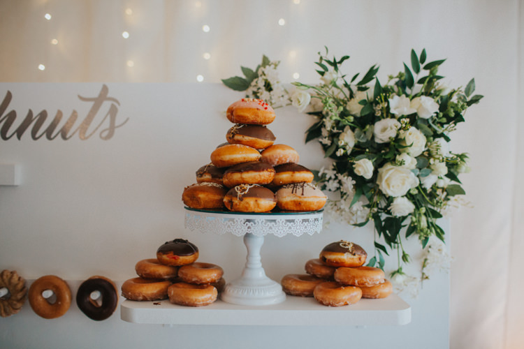 Doughnut Cake Stand Doughnut Wall White Rose Greenery Modern Calligraphy Chic Romantic Florals Candlelight Wedding http://lisawebbphotography.co.uk/
