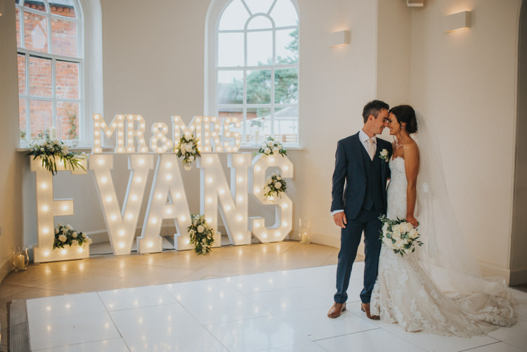 Bride Bridal Pronovias Strapless Sweetheart Fishtail Train Veil White Rose Bouquet Navy Suit Groom Light Up Circus Letters Chic Romantic Florals Candlelight Wedding http://lisawebbphotography.co.uk/