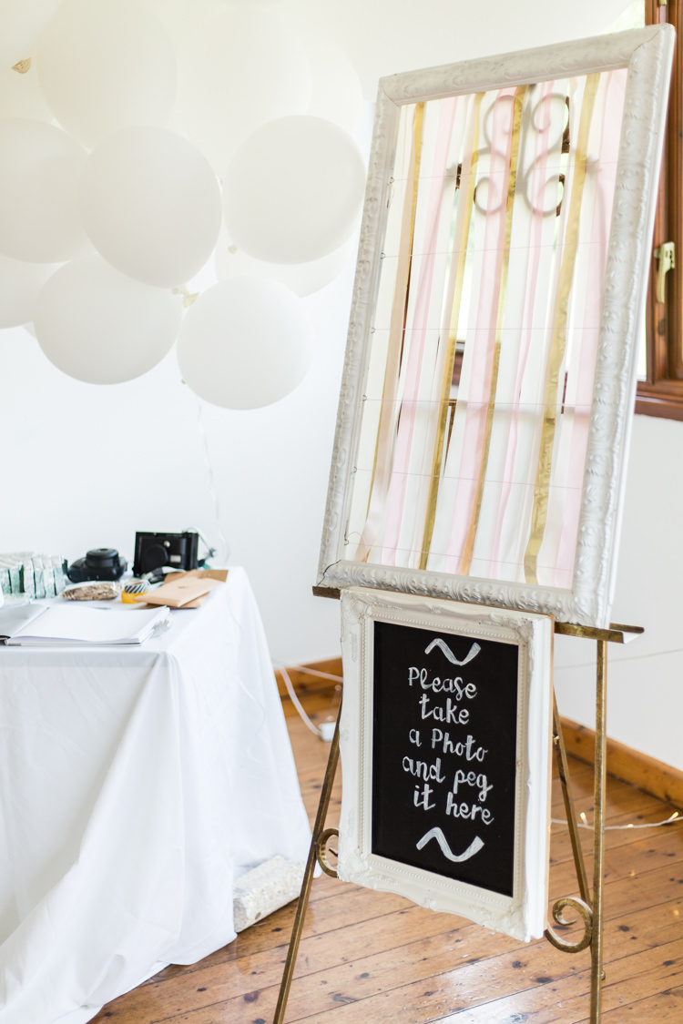 Photo Guest Book Polaroid Frame Streamers Chalk Board Balloons Natural Outdoor Tipi Wedding https://www.ad-photography.co.uk/