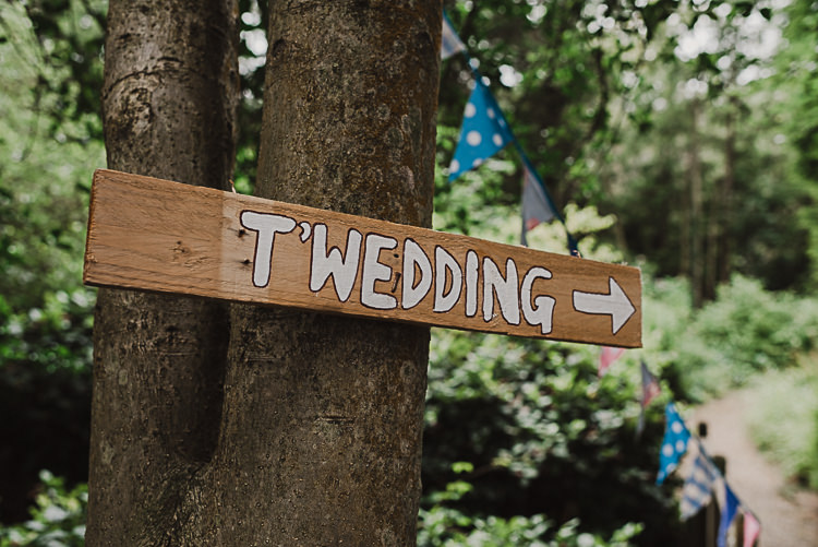 Wooden Rustic Painted Sign Post Stylish Woodland Tipi Wedding Flower Arch https://willpatrickweddings.com/