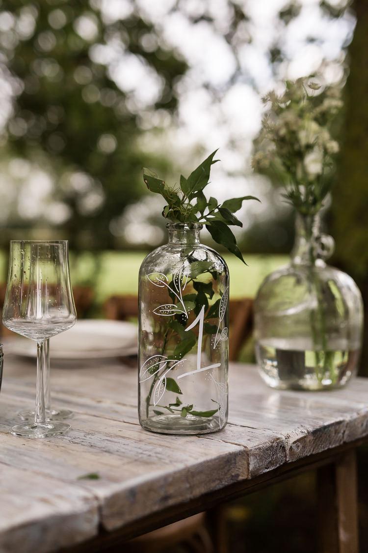 Bottle Foliage Decor Organic Rustic Greenery Wedding Ideas http://sarahbrookesphotography.com/