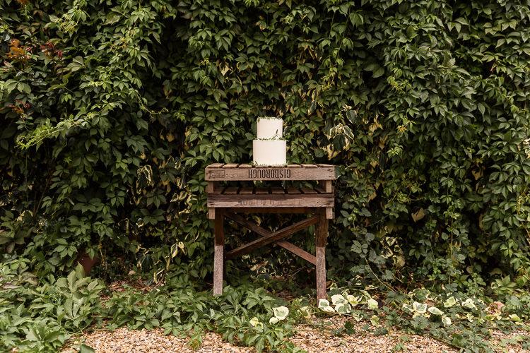 Wooden Cake Table Organic Rustic Greenery Wedding Ideas http://sarahbrookesphotography.com/
