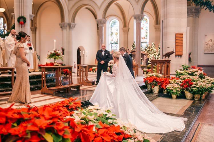 Christmas Decor Red Poinsettia Veil Train Cathedral Church Ceremony | Festive Glamour Christmas New Years Eve Wedding http://www.stevendrayimages.com/