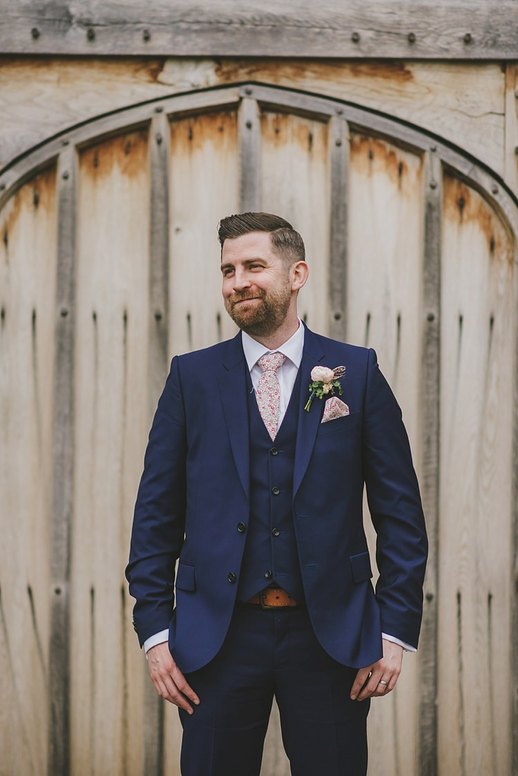 Navy Suit Floral Tie Groom Style Outfit Untraditional Pretty Travel Barn Wedding https://www.georgimabee.com/