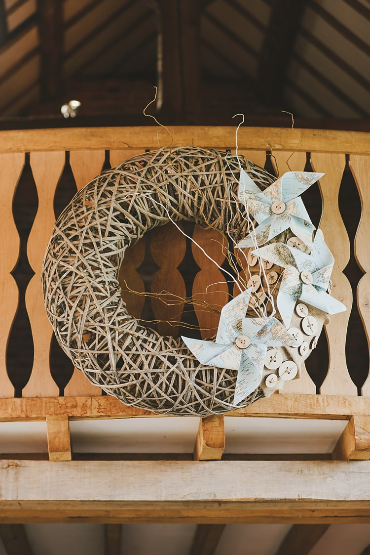 Wicker Wreath Pinwheels Decor Untraditional Pretty Travel Barn Wedding https://www.georgimabee.com/