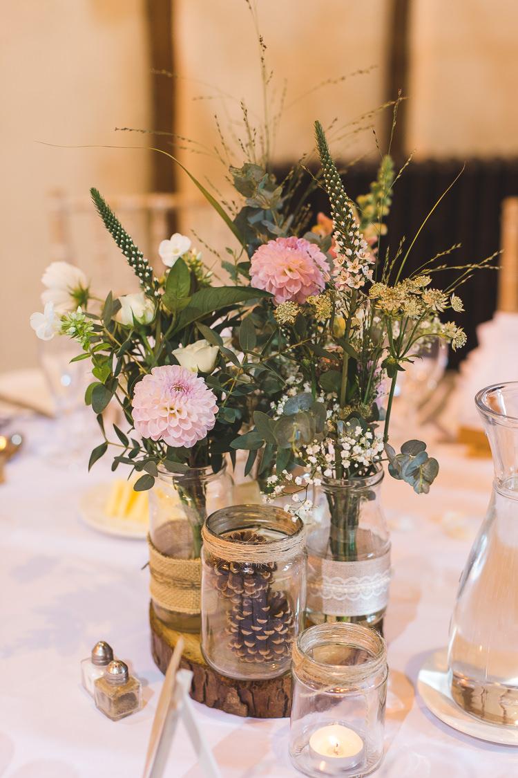 Wood Slice Table Centre Tree Jam Jars Hessian lace Twine Floral Flowers Tealight Whimsical Romantic Barn Wedding http://kirstymackenziephotography.co.uk/