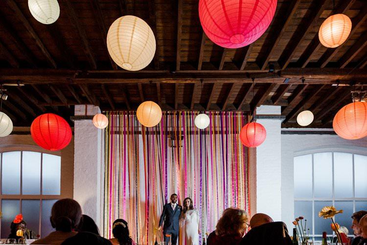 Ribbon Multicolour Backdrop Paper Lanterns Bright Very Colourful Quirky Fun City Wedding London http://www.babbphoto.com/