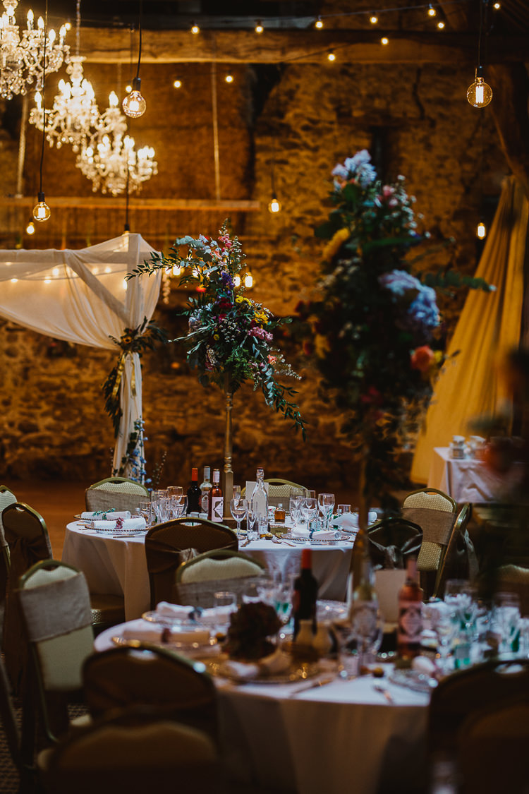 Flowers Tables Festoon Lights Decor Colourful DIY Floral Luxe Barn Wedding http://www.joemather-photography.co.uk/