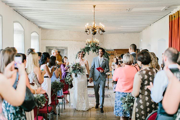 Destination Ceremony Bride Groom Aisle Wild Natural Bouquet Chandeliers Floral Arch | Romantic Castle Switzerland Wedding http://kbalzerphotography.com/