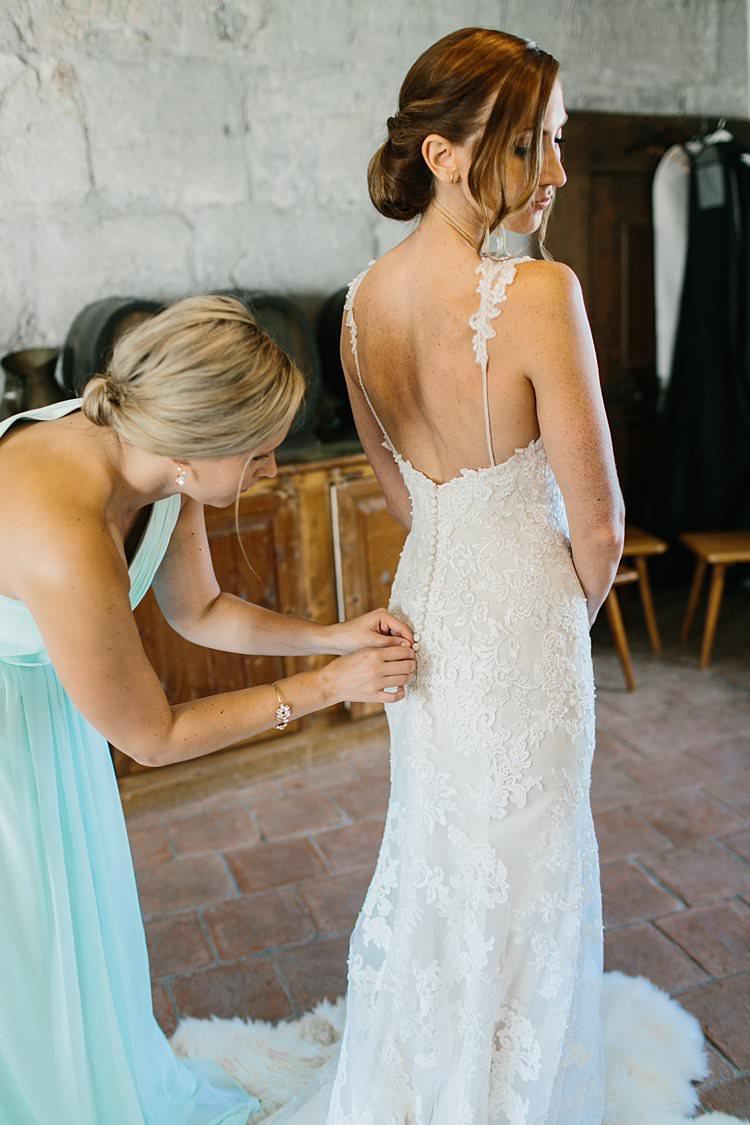 Bridal Prep Lace Spaghetti Strap Sweetheart Bride Updo Buttons Train | Romantic Castle Switzerland Wedding http://kbalzerphotography.com/