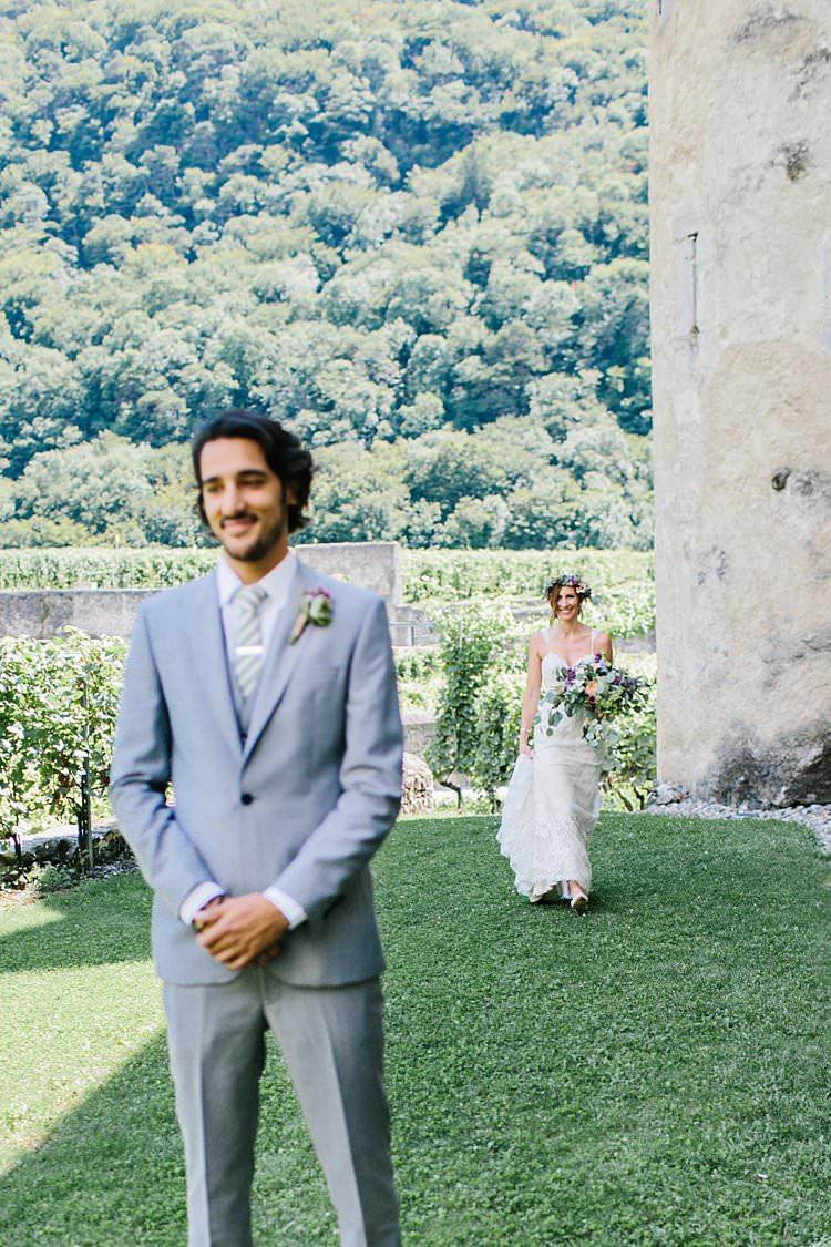 Destination Summer Sunny First Look Happy Groom Bride Bouquet | Romantic Castle Switzerland Wedding http://kbalzerphotography.com/
