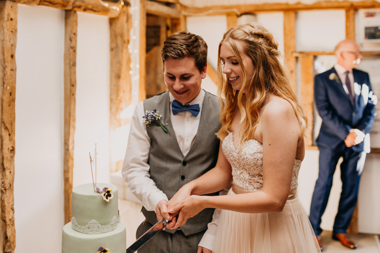Bride Groom Cake Cutting Green Lace Flowers Simple Natural   Rustic Relaxed Cornflower Blue Barn Wedding http://www.peterhugophotography.com/