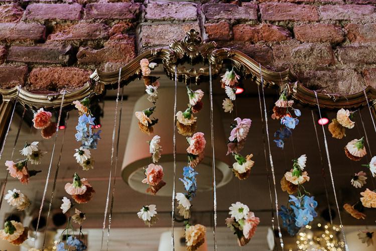 Urban Ceremony Backdrop Hanging Floral Curtain Pastel Wild Flowers | Glitter Dinosaurs City Wedding https://struvephotography.co.uk/
