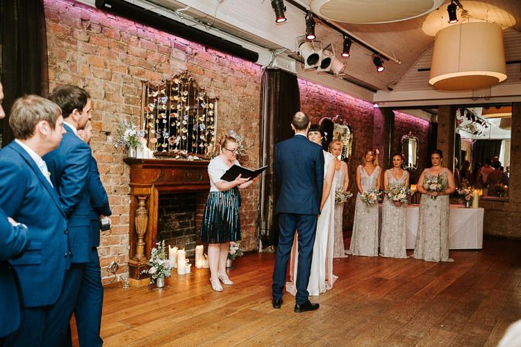 Urban Decor Ceremony Hanging Floral Curtain Bride Groom Celebrant | Glitter Dinosaurs City Wedding https://struvephotography.co.uk/