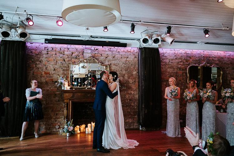 Urban Decor Ceremony Hanging Floral Curtain Bride Groom Cape Dress | Glitter Dinosaurs City Wedding https://struvephotography.co.uk/