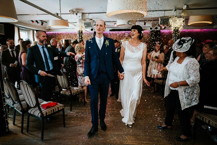 Bride Groom Glitter Sparkling Confetti Ceremony Aisle | Glitter Dinosaurs City Wedding https://struvephotography.co.uk/