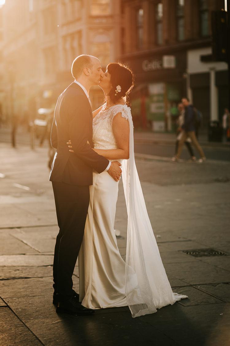 Bride Groom Walk City Street Photography Glasgow Scotland Kiss Cape | Glitter Dinosaurs City Wedding https://struvephotography.co.uk/