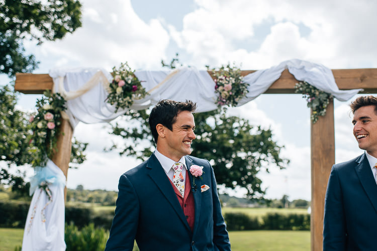 Red Waistcoat Groom Floral Tie Blue Suit Festival Bohemian Glamping Wedding https://theshannons.photography/