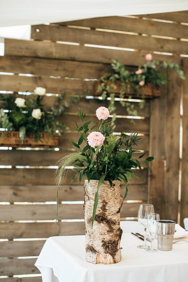 Log Bark Flowers Decor Tables Festival Bohemian Glamping Wedding https://theshannons.photography/