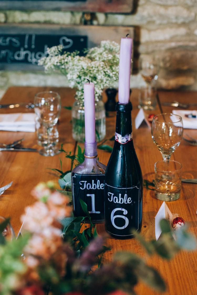 Bottle Candles Table Numbers Flowery Bohemian Secret Garden Wedding https://caseyavenue.co.uk/