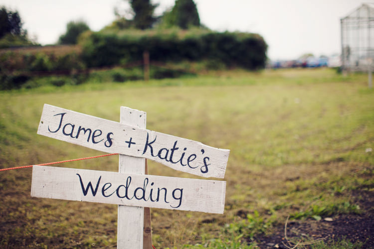 Painted Wooden Sign Post Relaxed Lavender Farm Marquee Wedding https://sashaleephotography.com/