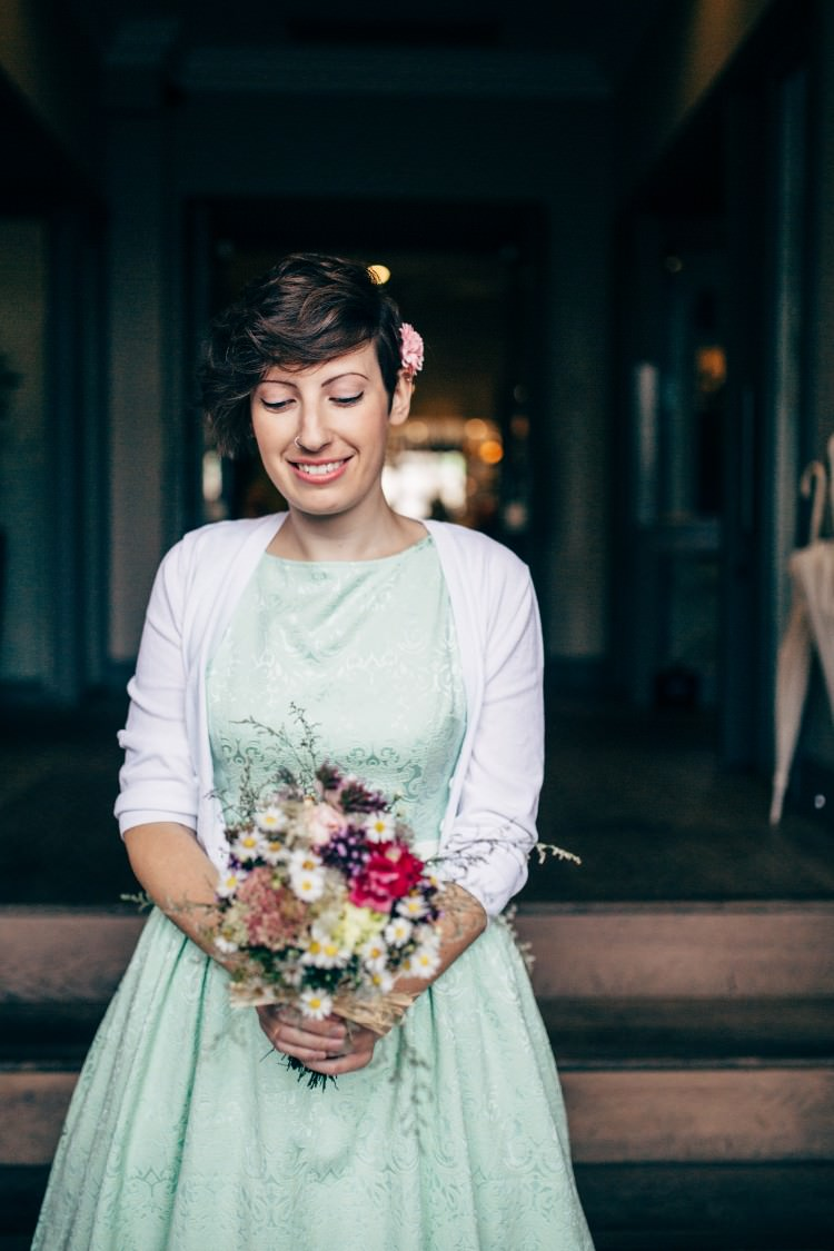 Bridesmaid Lindy Bop Mint Green 50s Tea Length Dress White Cardigan Retro Posy Bouquet Old Fashioned Fete Cricket Pavilion Wedding https://www.naomijanephotography.com/