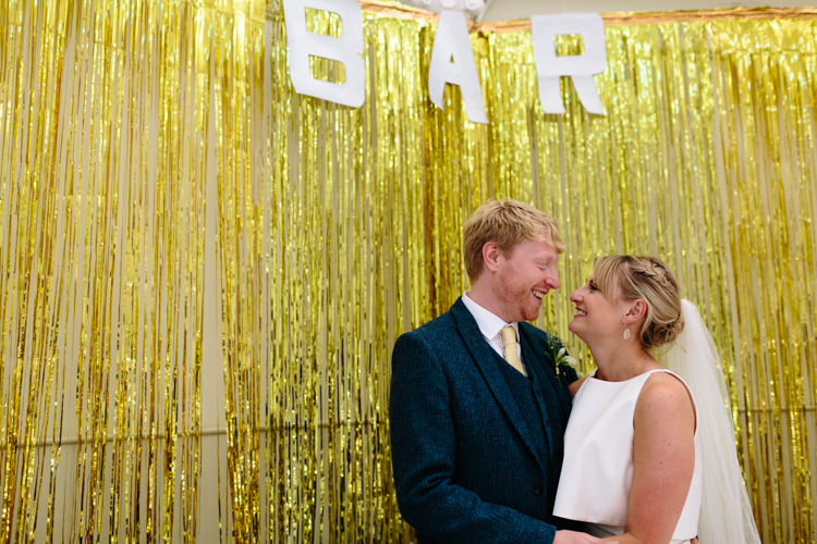 The Tab Centre London Shoreditch Couple Gold Glitter Curtain Bar Sign Fun Wedding | Modern Tropical Gold Urban Wedding https://www.christinewehrmeier.com/