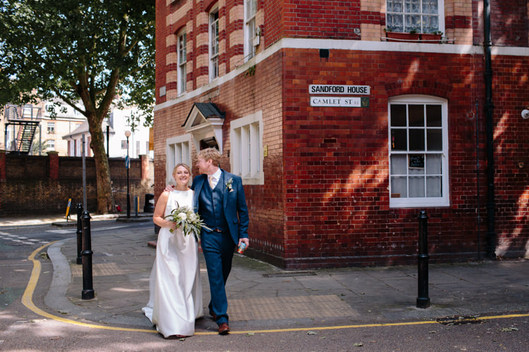 London City Bride Groom Buildings Street Foliage Greenery White Bouquet Jesus Peiro Dress Navy Suit | Modern Tropical Gold Urban Wedding https://www.christinewehrmeier.com/