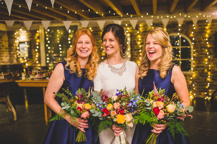 Bridesmaids Midnight Blue Bunting Pea Lights Fairy Lights Bride Bridal Floor Length T Shirt Neckline Short Sleeves Multicolour Wild Flower Bouquet Colourful Fun Cosy Rainy Sea Wedding http://www.livvy-hukins.co.uk/