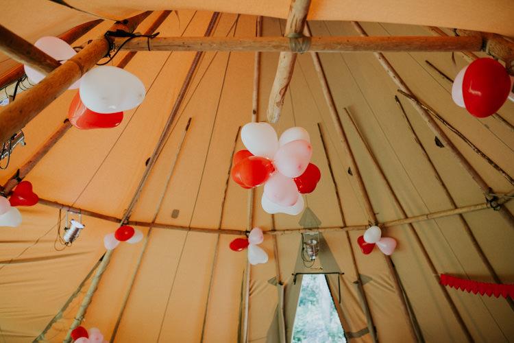Field Outdoor Garden Woodland Hippie Summer Giant Tipi Heart Balloons | Happy Outdoor Forest Mustard Yellow Wedding http://suzi-photography.com/