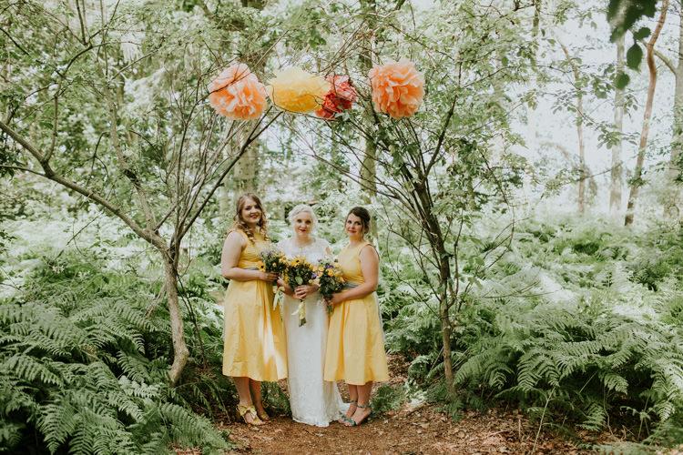 Field Outdoor Garden Tipi Hippie Bride Bridesmaids Paper Pompoms Flower Arch | Happy Outdoor Forest Mustard Yellow Wedding http://suzi-photography.com/